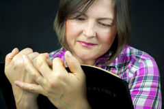 Adult Woman Reading a Bible Royalty Free Stock Photography