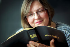 Adult Woman Reading a Bible Royalty Free Stock Photo