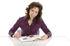 Adult woman reading a book Royalty Free Stock Images