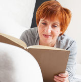 Adult woman reading book Stock Photo