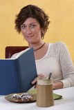 Adult woman reading. Adult woman thinking relaxing reading a book Royalty Free Stock Image