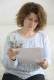 Adult woman with receipts and Russian money Royalty Free Stock Photos