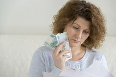 Adult woman with receipts and Russian money Royalty Free Stock Photo