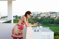 Woman using mobile in the terrace Stock Photography