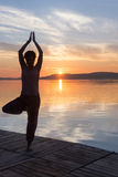 Adult woman relax while doing yoga exercises on Lake Balaton Royalty Free Stock Images