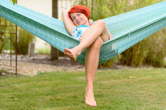 Adult Woman Relaxing on Hammock at the Garden Royalty Free Stock Photography