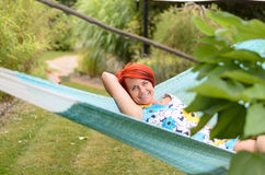 Adult Woman Relaxing on Hammock at the Garden Stock Photo