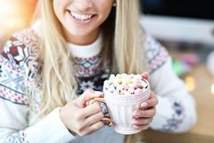 Adult woman relaxing at home during Christmas time royalty free stock photos