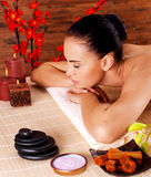 Adult woman relaxing in spa salon Stock Photos