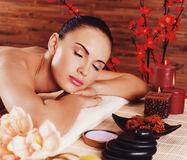 Adult woman relaxing in spa salon Royalty Free Stock Photo