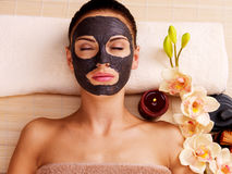 Adult woman relaxing in spa salon Royalty Free Stock Image