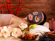 Adult woman relaxing in spa salon Stock Images