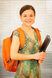 Adult woman representing lifelong learning. Woman with school ba Royalty Free Stock Photos
