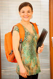 Adult woman representing lifelong learning. Woman with school ba Stock Image