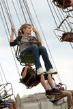 Adult Woman Rides Swings At County Fair Royalty Free Stock Image