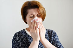 Adult woman with a runny nose Stock Images