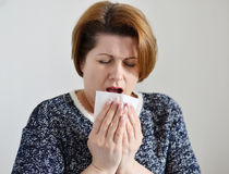 Adult woman with a runny nose Royalty Free Stock Image