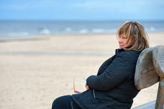 Adult woman at the sea stock photography