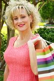 Adult woman with shopping bags Stock Photography