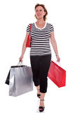 Adult woman with shopping bags isolated. Stock Photography