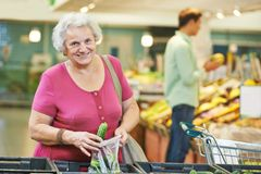 Adult woman shopping vegetables Royalty Free Stock Images