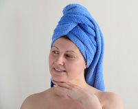 Adult woman after shower with towel on his head Stock Images