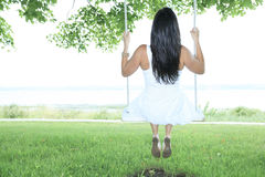 Adult woman sit on a swing Stock Photos