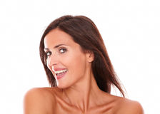 Adult woman smiling at camera with sensual look. Head and shoulders portrait of adult woman smiling at camera with her sensual look on isolated white background Stock Photos