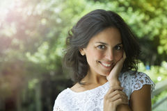 Adult woman smiling. Happy adult latin woman smiling outdoors Stock Photos