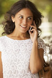 Adult woman smiling on the phone Royalty Free Stock Photo