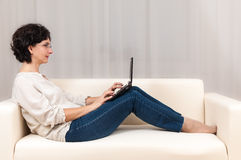 Adult woman using technology small laptop Stock Images