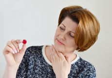 Adult woman with a sore throat Royalty Free Stock Images
