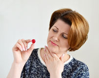 Adult woman with a sore throat Royalty Free Stock Photography