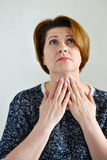 Adult woman with a sore throat Stock Photography