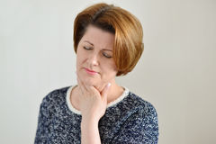 Adult woman with a sore throat Royalty Free Stock Photo