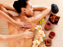 Adult woman in spa salon having body massage. Stock Photo