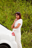 Adult woman standing by car Stock Photos
