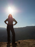 Adult woman standing in the sun Royalty Free Stock Photography