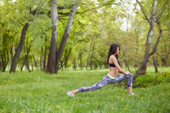 Adult woman stretching legs muscles before workout. stock images