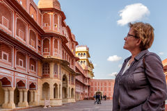 Adult woman studying the palace Stock Photography