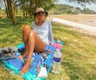 Woman chilling on green shoreline stock photo
