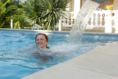 Adult woman swims in the pool Royalty Free Stock Images