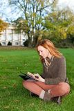 Adult woman with tablet pc, outdoors Royalty Free Stock Photography