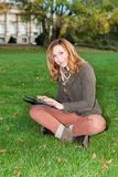 Adult woman with tablet pc, outdoors Royalty Free Stock Photo