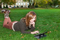 Adult woman with tablet pc, outdoors Stock Images