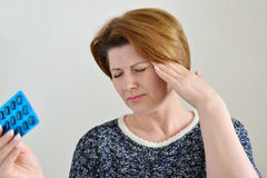 Adult woman taking a pill for  headache Stock Images