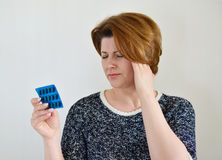 Adult woman taking a pill for  headache Stock Photography