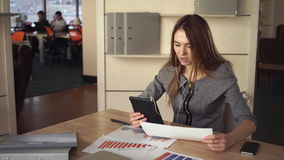 The Adult Woman Talking With Customer On The Tablet stock footage