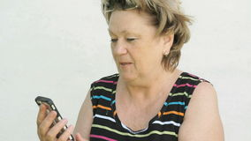 Adult woman talking with husband using smart phone stock footage