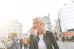 Adult woman talking on the phone in London Royalty Free Stock Photography